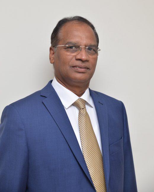 Krishna Nadimpalli in a blue suit
